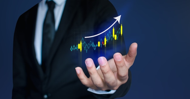 Business people are using stock chart innovative technology. mixed media, digital smartphone and online shopping concept.