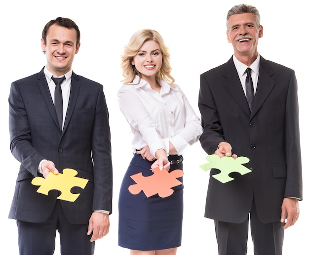 Business people are wanting puzzle together on white.