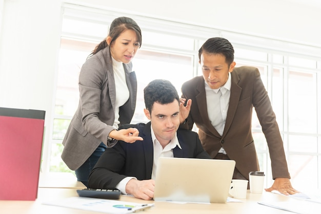 Business people blaming man colleague
