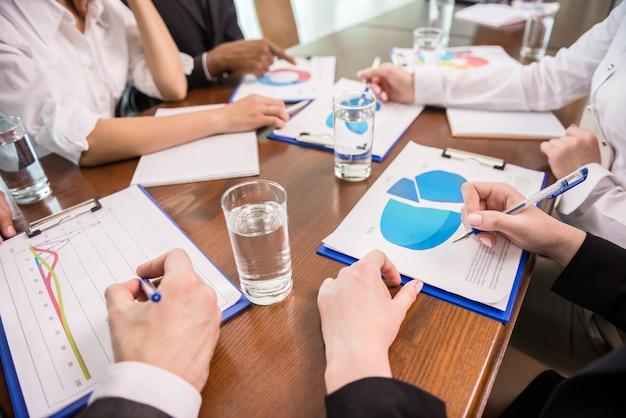 Business people brainstorming together in meeting room.