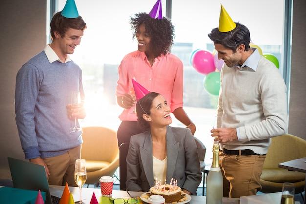 Business people celebrating birthday