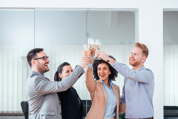 Business people celebrating success with glass of champagne.