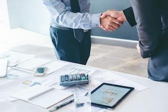 Business people colleagues shaking hands