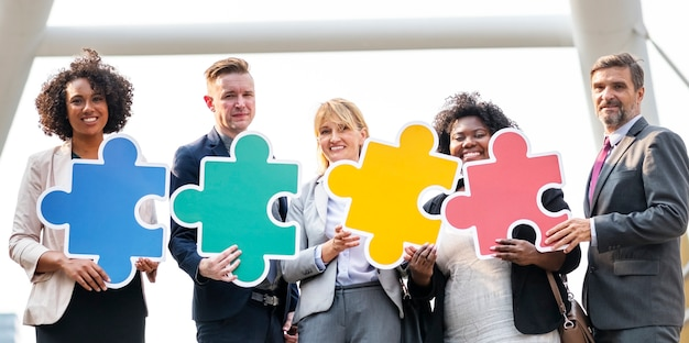 Business people connected by puzzle pieces