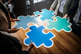 Business people connecting puzzle pieces
