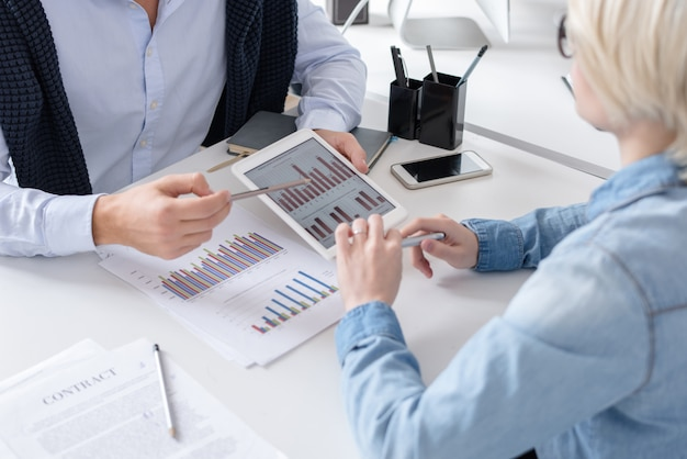 Business people discussing report in office