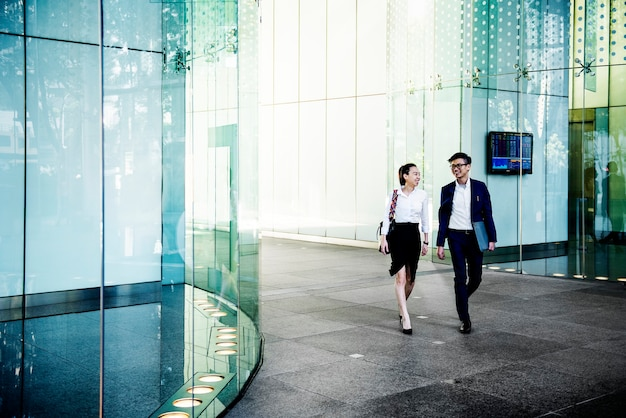 Business people in a discussion while walking together