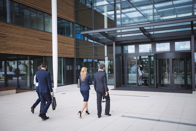 Business people entering in to an office building