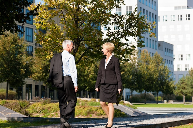 Business people greeting outdoors