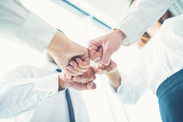 The business people greeting with a fist