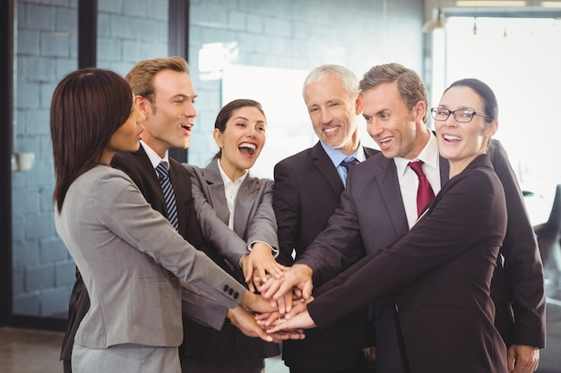 Business people hands stacked over each other