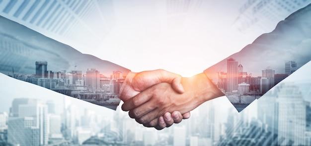 Business people handshake on city