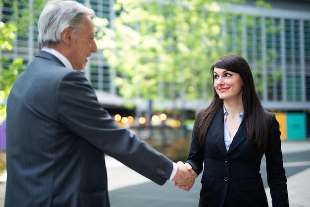 Business people handshake outdoor