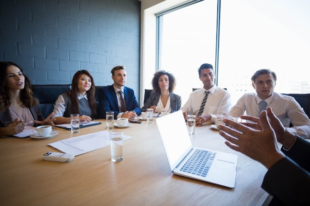 Business people having a discussion in conference room in office
