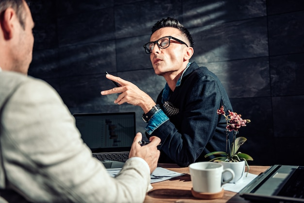 Business people having discussion at a meeting