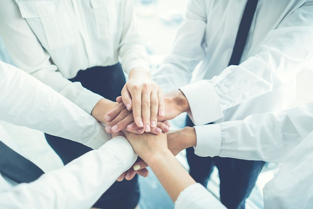 The business people hold hands together