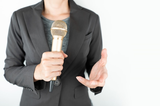 Business people holding microphone isolated on white