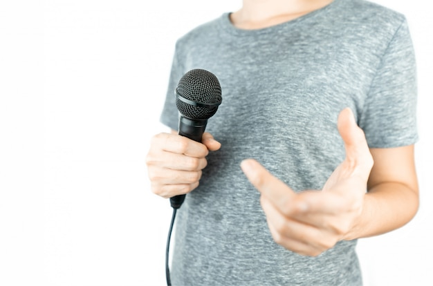 Business people holding microphone isolated