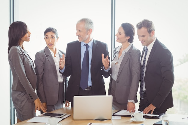 Business people interacting in conference room