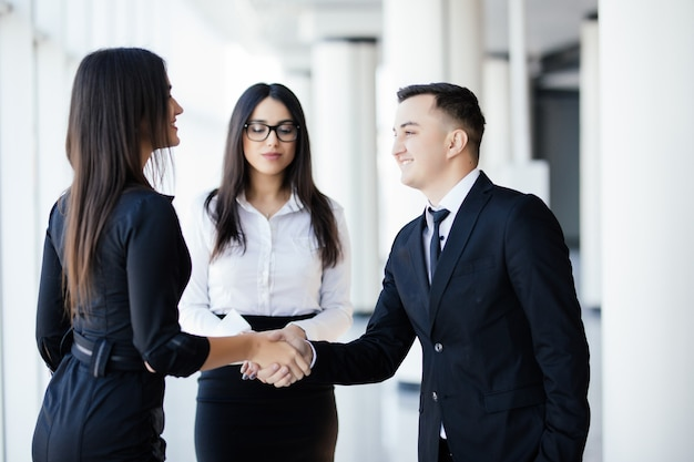 Business people man and woman shaking hands, finishing up a meeting