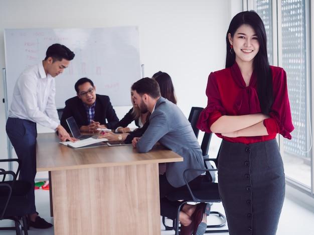 Business people in meeting room,businesswoman cross arm in room