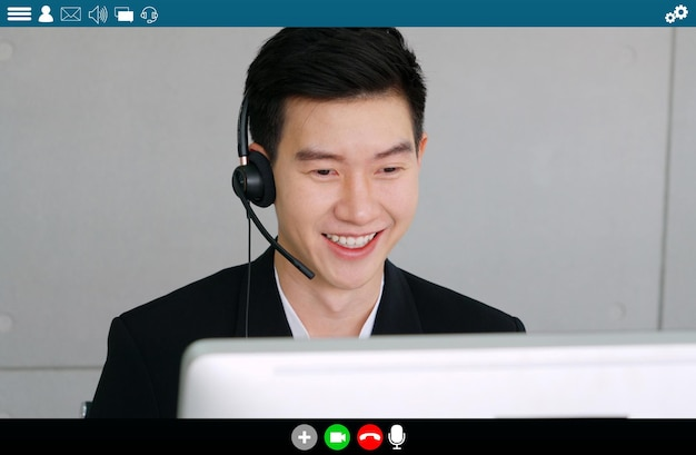 Business people meeting in video conference app on laptop monitor view