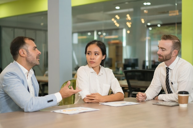 Business people meeting and working at desk in office