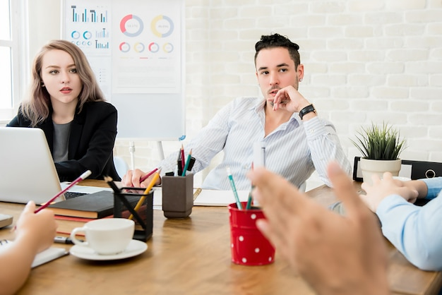 Business people paying attention to their colleague in meeting