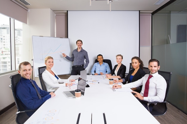 Business people posing smiling in a meeting room