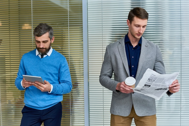 Business people reading in office