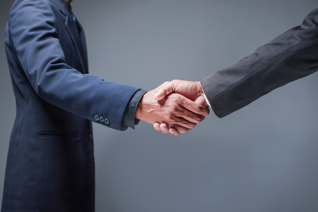 Business people shake hands