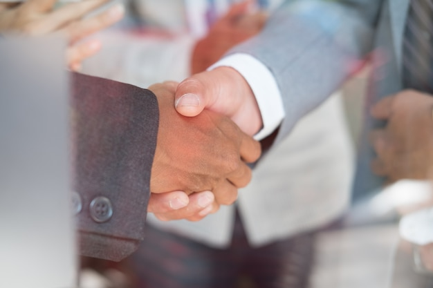 Business people shaking hands after finishing up a meeting.