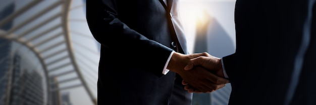 Business people shaking hands, close up hand shake of successful negotiate businessman agreement and success in contract