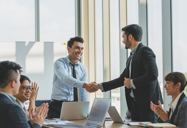 Business people shaking hands congratulations to work success