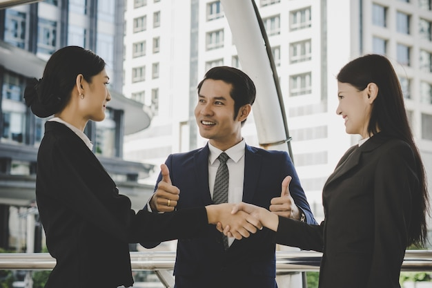 Business people shaking hands, finishing up meeting deals. business concept.