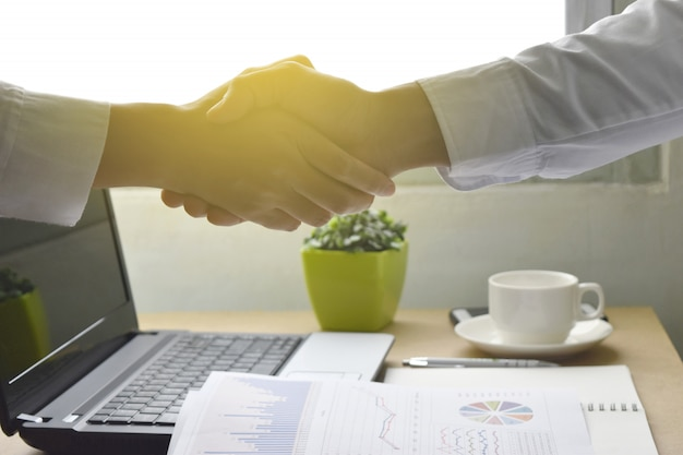 Business people shaking hands happy with work agreement