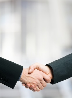 Business people shaking hands. lots of copy-space