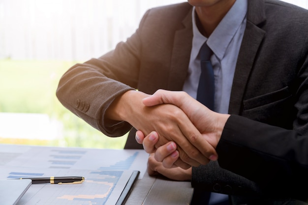 Business people shaking hands partner successful team leader and business  meeting.
