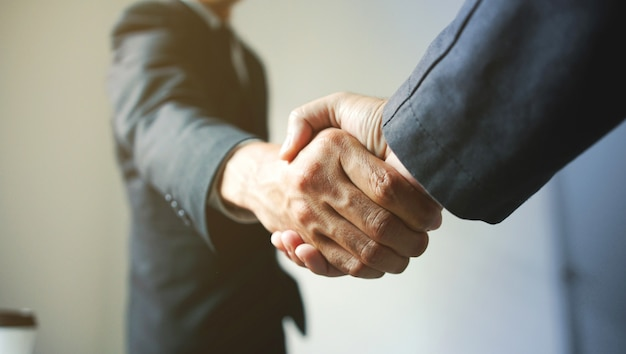 Business people shaking hands, success