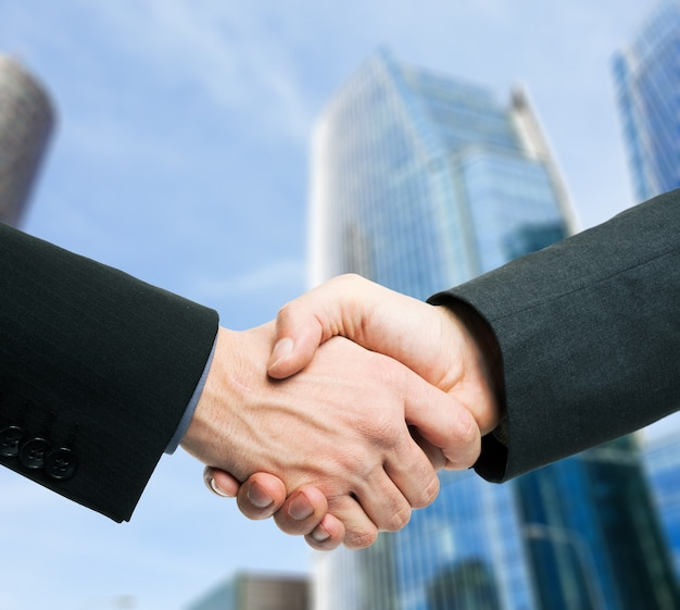 Business people shaking hands in an urban business environment