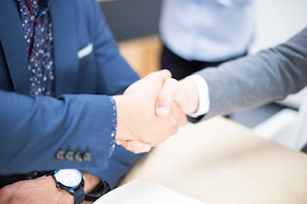 Business people shaking hands when finishing up a meeting