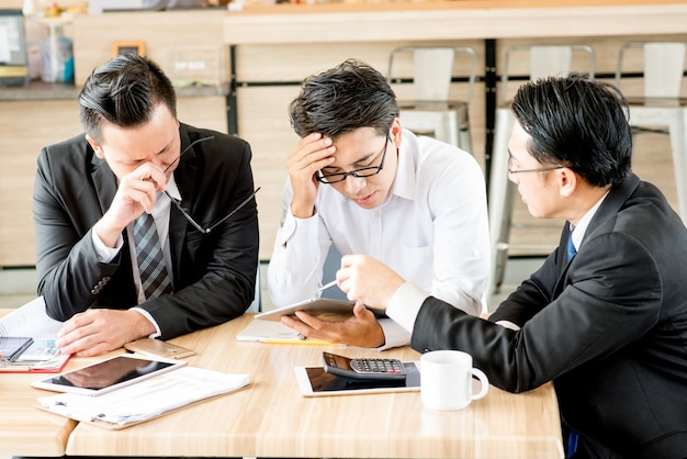 Business people show stressed of distress in meeting room
