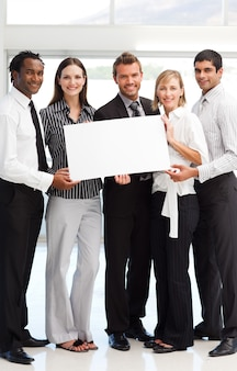 Business people showing a big white card