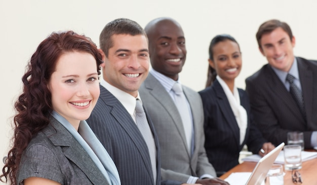 Business people sitting in a meeting and smiling