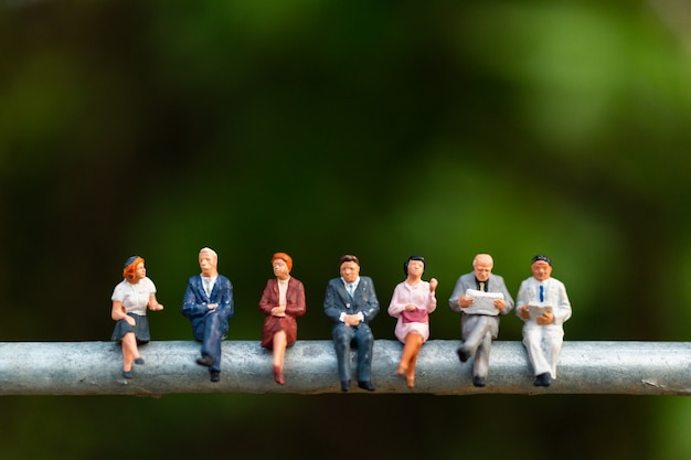 Business people sitting on a  wire