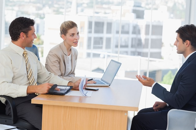 Business people speaking during interview