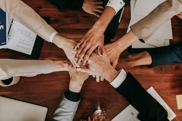 Business people stacking their hands together