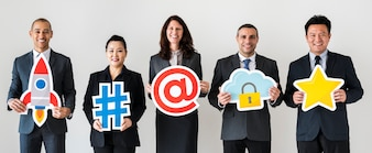 Business people standing and holding icons