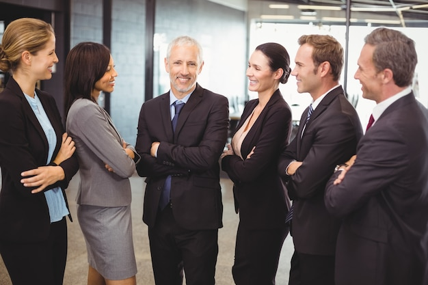 Business people standing together with arms crossed