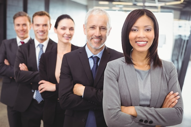 Business people standing with arms crossed